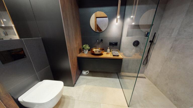 Fotografia wnętrz miedziana umywalka w łazience